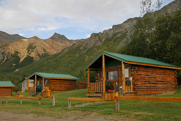 lodge cabins with mountain background